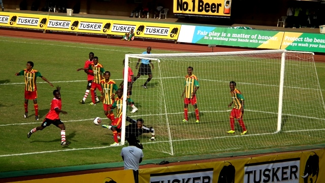 A South Sudan player (red&black) heading for the ball